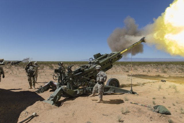 Soldiers assigned to 2nd Battalion, 3rd Field Artillery Regiment, 1st Brigade Combat Team, 1st Armored Division, fire a M777 Howitzer during Hustler Trough III, May 23, at the Orogrande Range Complex, N.M.