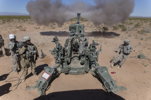 Soldiers assigned to 2nd Battalion, 3rd Field Artillery Regiment, 1st Brigade Combat Team, 1st Armored Division, fire a M777 Howitzer during Hustler Trough III May 23 at the Orogrande Range Complex, N.M.