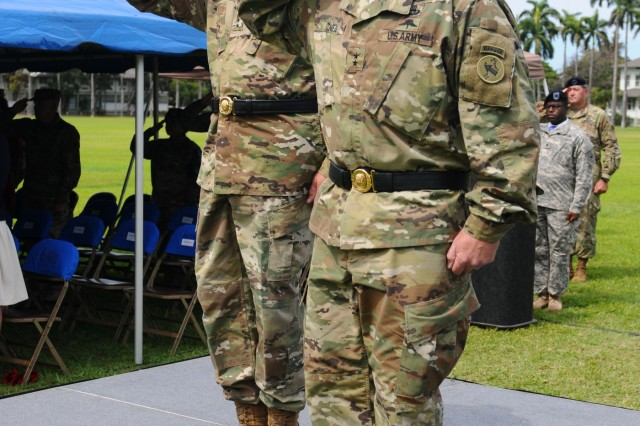 "U.S. Army Pacific Commanding General Gen. Robert B. Brown (left) and J Maj. Gen. Mark J. O'Neil, Chief of Staff, USARPAC, salute the colors during the playing of the national anthem at a Flying ""V"" ceremony held at historic Palm Circle, Fort Shafter, Hawaii, June 3. The Flying ""V"" ceremony was held to honor O'Neil as he arrives to fill the role of USARPAC Chief of Staff. The ""V"" refers to the way the colors are posted during the ceremony, which is V-shaped. (U.S. Army photo by Staff Sgt. Chris McCullough, U.S. Army Pacific Public Affairs)"