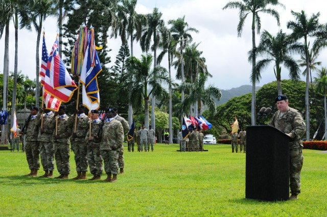 "Maj. Gen. Mark J. O'Neil (right), Chief of Staff, USARPAC, delivers his speech during at a Flying ""V"" ceremony held at historic Palm Circle, Fort Shafter, Hawaii, June 3. The Flying ""V"" ceremony was held to honor O'Neil as he arrives to fill the role of USARPAC Chief of Staff. The ""V"" refers to the way the colors are posted during the ceremony, which is V-shaped. (U.S. Army photo by Staff Sgt. Chris McCullough, U.S. Army Pacific Public Affairs)"