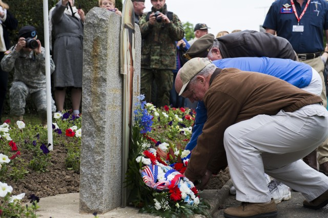 PICAUVILLE, France (June 03, 2016) Participants lay ceremonial wreaths at the 90th Infantry Division Memorial Ceremony, June 3, to honor the sacrifices of WWII veterans. More than 380 service members from Europe and affiliated D-Day historical units are participating in the 72nd anniversary as part of Joint Task Force D-Day 72. The Task Force, based in Saint Mere Eglise, France, is supporting local events across Normandy, from May 30 -- 6 June , 2016 to commemorate the selfless actions by all the allies on D-Day that continue to resonate 72 years later.