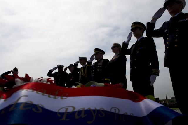 UTAH BEACH, France (June 04, 2016) Military members from the U.S., France and Germany along with government officials salute during the playing of the national anthems at the Utah Beach Memorial Ceremony, June 4. More than 380 service members from Europe and affiliated D-Day historical units are participating in the 72nd anniversary as part of Joint Task Force D-Day 72. The Task Force, based in Saint Mere Eglise, France, is supporting local events across Normandy, from May 30 -- 6 June , 2016 to commemorate the selfless actions by all the allies on D-Day that continue to resonate 72 years later