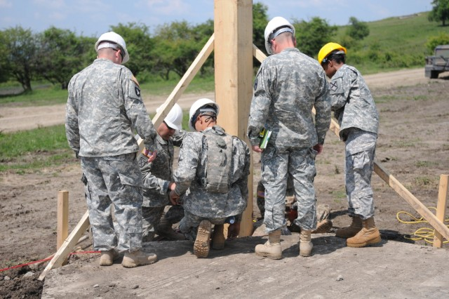 Sgt. 1st Class Terry Glover, quality control specialist with the 194th Civil Engineer Battalion, Tennessee Army National Guard; and Capt. Ternisha Miles, Safety Officer, Alabama Army National Guard, details about the next stages of building a multipurpose building on Cincu Training Range on May 22, 2016 in Cincu, Romania.  Staff Sgt. Smith and the other Soldiers are participating in this year's Resolute Castle 16, a joint training mission between the US Military and NATO allies focused on building strong partnerships and enhancing training missions for National Guard troops' Annual Training.