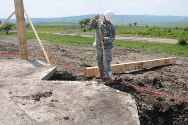 Staff Sgt. John Smith, masonry and carpentry supervisor, 877th Engineer Battalion, Alabama Army National Guard, works on the foundation around a multipurpose building on Cincu Training Range on May 22, 2016 in Cincu, Romania.  Staff Sgt. Smith is working on multiple building sites during Resolute Castle 16, a joint training mission between the U.S. and our NATO allies including Romanian Land Forces.  These buildings are part of a plan to improve the Cincu Training Range for the Romanian Land Forces.