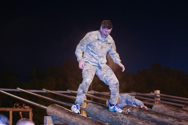 Acting Secretary of the Army Patrick Murphy navigates his way through the Peden Field obstacle course, Fort Benning, Ga., April 18,2016, with more than 100 OCS Soldiers.