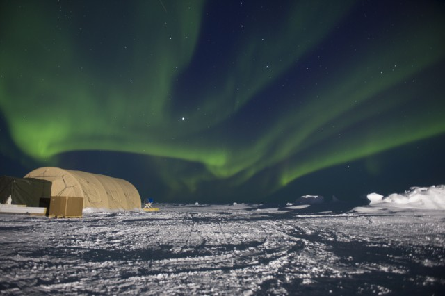 The Natick Soldier Research, Development and Engineering Center, or NSRDEC, provided shelter support to the Navy during its biannual Ice Exercise in the Arctic Ocean. NSRDEC provided the Navy with shelters featuring airbeam technology (pictured here under northern lights), which consists of inflatable, high-pressure arches.