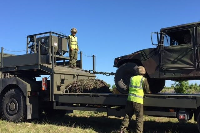Members of the British 19th Tank Transporter Squadron recover an American HMMWV. A multinational training event was coordinated between the 10th Army Air and Missile Defense Command, the Polish 3rd Surface to Air Missile Brigade, and the British 19th Tank Transporter Squadron in order to validate the ability of these units to interoperate during the recovery of non-mission capable of wrecked vehicles from June 6 to 7.