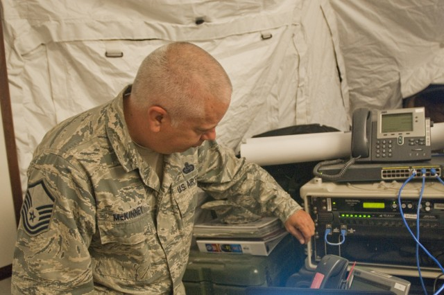 Master Sgt. James K. McKinney, 225 Air Control Squadron, an element of the Mississippi National Guard, cyber operations NCOIC, setup cyber communication for units to accomplish missions, during the Multi-echelon Integrated Brigade Training (MiBT) exercise, June 7, 2016, at Fort Hood, Texas. A MiBT is a multicomponent training event that sustains readiness of reserve and active components in accordance with the U.S. Army's Total Force policy.