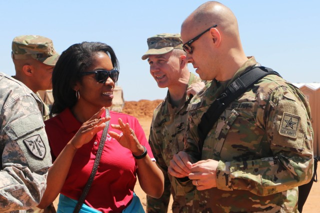 During Network Integration Evaluation 16.2 at the 2nd Brigade Combat Team, 1st Armored Division's Main Tactical Operations Center, Steffanie Easter, principal deputy assistant secretary of the Army for Acquisition, Logistics and Technology, shares her reaction to the systems being evaluated with her Executive Officer, Lt. Col. Gregory Fortier, at Fort Bliss, Texas.