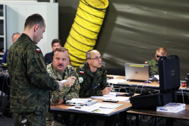 A Polish CIS officer briefs Col. Matthew Holt, U.S. Army Europe deputy G6, and Polish Army CIS staff members during a daily network systems update briefing during Exercise Anakonda 2016 June 8 at the National Defense University in Warsaw, Poland.