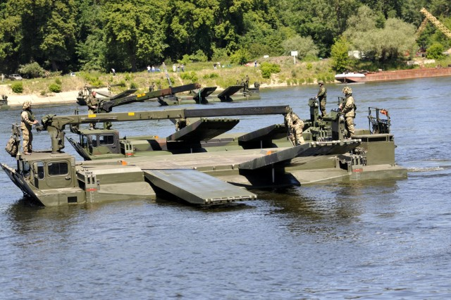In a joint bridge crossing demonstration, U.S., U.K., German and Polish troops combined efforts and equipment to set a new world record for the longest amphibious vehicle bridge built near Chelmno, Poland June 8 during Anakonda 16. Exercise Anakonda 2016 is a Polish-led, multinational premier training event taking place throughout Poland June 7-17.