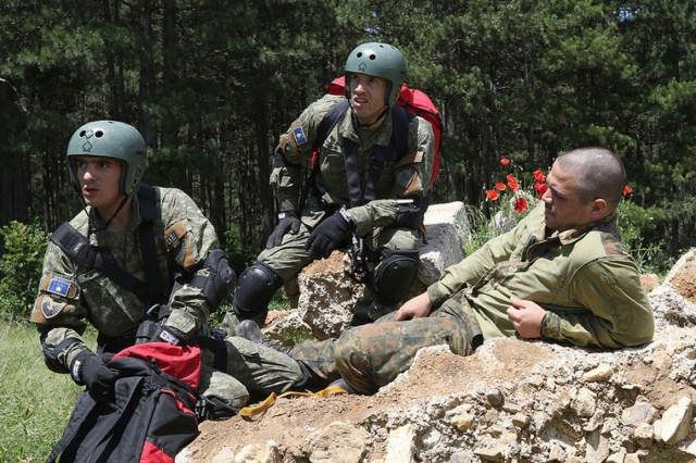 Members of the Kosovo Security Force's Search and Rescue Team receive guidance from medical professionals while preparing a casualty for evacuation during Operation Silver Saber in Pomozetin, Kosovo, June 3. (U.S. Army photo by: Staff Sgt. Thomas Duval, Multinational Battle Group-East Public Affairs)