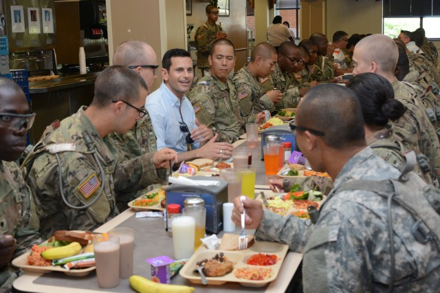 Secretary Fanning's chief of staff, Alex Wagner, talks with Basic Combat Training Soldiers at lunch during the Secretary of the Army's June 7 visit to Fort Jackson.