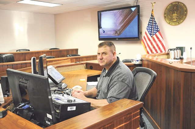 Bob Michael, Fort Leonard Wood court reporter, one of about 24 in the U.S. Army, sits with the tools of his trade in the Fort Leonard Wood courtroom.