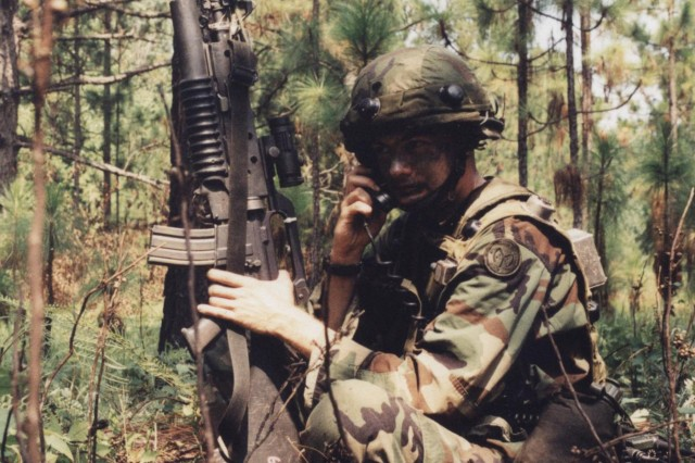 """A Soldier of the New York Army National Guard's 27th Brigade uses a radio at the Army's Joint Readiness Training Center (JRTC) at Fort Polk Louisiana during the brigade's war-fighting exercises there in August, 2001. The unit, now designated the 27th Infantry Brigade Combat Team (IBCT), is heading there again for war-fighting exercises in July. New York Army National Guard combat veterans, who trained with the brigade at JRTC in 2001, praised JRTC, saying it prepared them for overseas deployments during America's war on terror. Sgt. 1st Class Justin Westfall, of Valatie, N.Y., said undergoing simulated casualties at JRTC teaches Soldiers how to evacuate wounded troops, and to step up - and into - leadership roles. """"At one point there were four people left in the platoon,"""" Westfall said. """"It teaches you to carry out missions with limited resources. (JRTC) really gives you the 'next man up' situation. You have to know what the mission is and what the scenario is and keep things moving forward."""" (U.S. Army National Guard file photo/released)"""