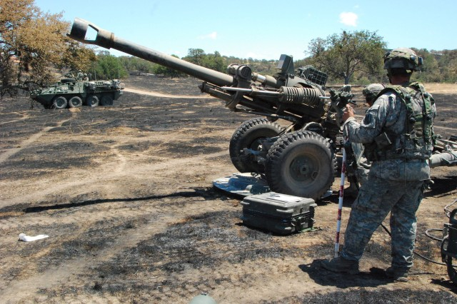 During annual training in May 2016 Soldiers from Bravo Battery, 1st Battalion, 143rd Field Artillery Regiment, based out Ventura and Santa Maria, of the California Army National Guard, conducted a platoon defense lanes training on the recently scorched earth of Camp Roberts. Their task was to set up their guns and begin fire missions while defending their position against active duty Soldiers from 4-17th Infantry out of Fort Bliss acting as enemy combatants. Strykers from the same infantry unit supported the National Guard unit in defense. Approx. 30 troops, including 1st Lt. Bloom, Sgt. 1st Class Phillips and Bailes quickly positioned their men and fought off the enemy until the call came to uproot their guns and move out. Video evaluation personnel from Fort Hunter Liggett and skill set subject-matter-experts from First Army were on-hand to grade the unit's performance as part of the much larger XCTC operation commanded by the battery's higher headquarters, the 79th Infantry Brigade Combat Team.