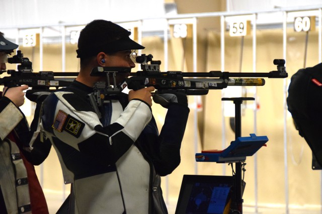 Spc. Dan Lowe, U.S. Army Marksmanship Unit (USAMU), aims downrange during the 2016 Air Olympic Trials, where he won an air rifle seat on the U.S. Olympic Shooting Team June 5. Lowe will join three other USAMU Soldiers at the 2016 Games in Rio de Janeiro in August.
