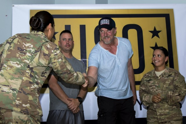 Country music star Trace Adkins meets Soldiers during his visit to Camp Arifjan, Kuwait as part of the USO's 75th Anniversary Concert Series, June 8. Adkins spent time with troops answering questions, signing autographs, posing for photos and also performed a concert to show his support for the United States military. (Photo by Spc. Angela Lorden/Released)