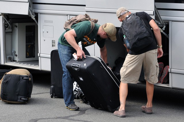 Athletes of Team Army unload personal gear and equipment after arriving at the United States Military Academy at West Point, N.Y., June 7, 2016. The DoD Warrior Games, June 15-21, is an adaptive sports competition for wounded, ill and injured service members and Veterans. Athletes representing teams from the Army, Marine Corps, Navy, Air Force, Special Operations Command and the British Armed Forces compete in archery, cycling, track and field, shooting, sitting volleyball, swimming, and wheelchair basketball. (U.S. Army Photo by Master Sgt. D. Keith Johnson/Released)