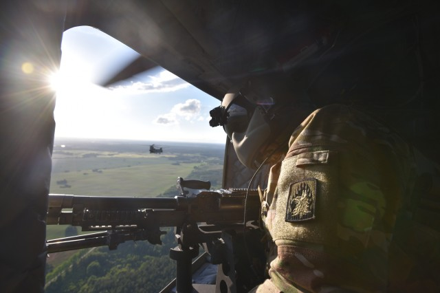 Sgt. Michael Hagen, a 15U CH-47 Chinook Crew Chief, from Hotel Company, 1st Battalion, 214th Aviation Regiment, 12th Combat Aviation Brigade scans his sector aboard a CH-47 helicopter during a battalion size air assault, June 10, outside Wedrzyn, Poland. Sky Soldiers from 1st Battalion, 503rd Infantry Regiment, 173rd Airborne Brigade during the air assault mission. Anakonda 2016 is a Polish national exercise that seeks to train, exercise and integrate Polish national command and force structures into an allied, joint, multinational environment.