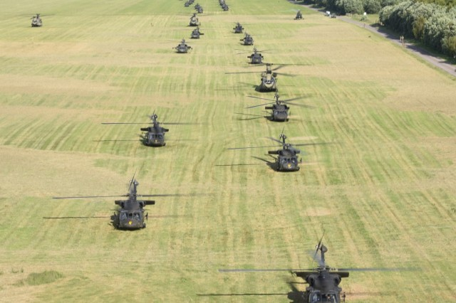 "Helicopters from the Polish 1st Army Aviation Brigade, 25th Air Cavalry Brigade, and the U.S. 12th Combat Aviation Brigade ""Task Force Griffin,"" are staged for a battalion size air assault of over 400 Sky Soldiers from 1st Battalion, 503rd Infantry Regiment, 173rd Airborne Brigade during exercise Anakonda 16, June 10, at the 21st Tactical Air Base in Swidwin, Poland.  Anakonda 2016 is a Polish national exercise that seeks to train, exercise and integrate Polish national command and force structures into an allied, joint, multinational environment."