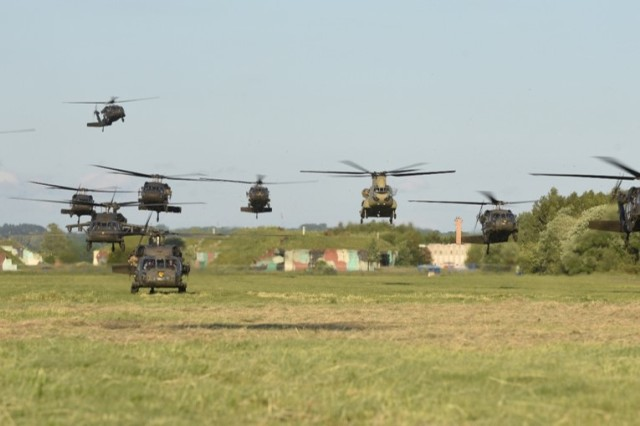 "Helicopters from the Polish 1st Army Aviation Brigade, 25th Air Cavalry Brigade, and the U.S. 12th Combat Aviation Brigade ""Task Force Griffin,"" are staged for a battalion size air assault of over 400 Sky Soldiers from 1st Battalion, 503rd Infantry Regiment, 173rd Airborne Brigade, during exercise Anakonda 16, June 10, at the 21st Tactical Air Base in Swidwin, Poland.  Anakonda 2016 is a Polish national exercise that seeks to train, exercise and integrate Polish national command and force structures into an allied, joint, multinational environment."