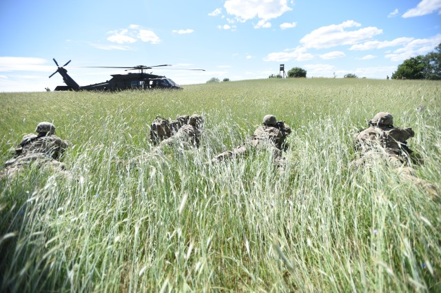 Sgt. Alfred Pinedo, Spc. Mylz Wade, Pfc. Cody Farnsworth and Pfc. Kevyn Jones, 11B Infantrymen, from 1st Battalion, 503rd Infantry Regiment, 173rd Airborne Brigade pull security from the prone position after exiting a UH-60 Black Hawk helicopter from 3rd Battalion, 227th Aviation Regiment, 1st Air Cavalry Brigade during exercise Anakonda 16, June 11, outside Wedrzyn, Poland. Anakonda 2016 is a Polish national exercise that seeks to train, exercise and integrate Polish national command and force structures into an allied, joint, multinational environment.