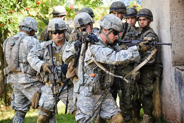 U.S. and NATO paratroopers with Task Force Devil, a multinational force led by the 1st Brigade Combat Team, 82nd Airborne Division, conduct pre-mission combined training on Aug. 21, 2015, in Baumholder, Germany.