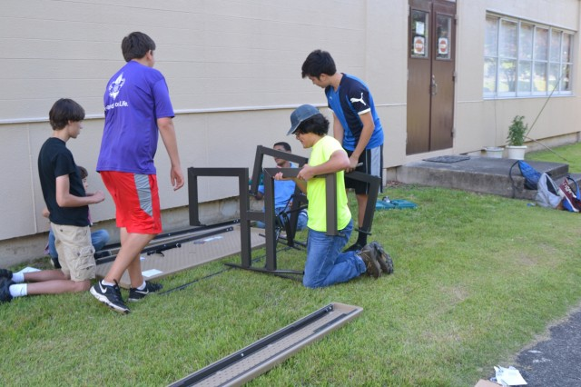 Members of the Camp Zama Boy Scouts Troop 34 put together a picnic table as part of one troop member's Eagle Scout Service Project, June 8 outside of USAG Japan Headquarters' building. (U.S. Army photo by Candateshia Pafford)