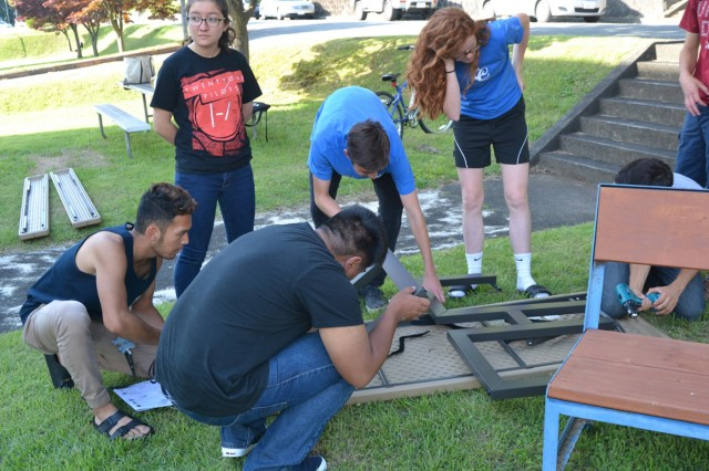 ZAHS Keystone Club members put together a picnic table as part of fellow Keystone Club member and Camp Zama Boy Scouts member, Lorenzo Cardenas's Eagle Scout Service Project, June 8 outside USAG Japan Headquarters' building. (U.S. Army photo by Candateshia Pafford)