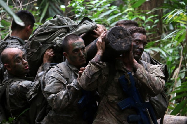 U.S. Army Soldiers with Company B, 3rd Battalion, 7th Infantry Regiment, 2nd Infantry Brigade Combat Team, 3rd Infantry Division carry their platoon leader atop a log during Jungle Warfare School in Gabon, June 9, 2016. Soldiers are attending the French Jungle Warfare School as part of U.S. Army Africa's exercise Central Accord 2016, an annual, combined, joint military exercise that brings together partner nations to practice and demonstrate proficiency in conducting peacekeeping operation.