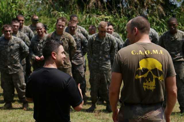 A U.S. Army Jungle Operations Traning Center instructor (left) with Lightning Academy, Headquarters and Headquarters Battalion, 25th Infantry Division and French Jungle Warfare School instructor (right) brief the purpose of the obstacle course during Jungle Warfare School in Gabon, June 8, 2016. Soldiers are attending the French Jungle Warfare School as part of U.S. Army Africa's exercise Central Accord 2016, an annual, combined, joint military exercise that brings together partner nations to practice and demonstrate proficiency in conducting peacekeeping operations.