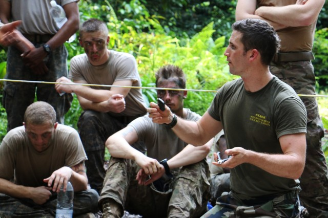 French Chief Cpl. Miguel, an instructor with the French Jungle Warfare School in Gabon, shows U.S. Army Soldiers basic items for jungle security operations June 10, 2016. Soldiers of Bravo Company, 3rd Battalion, 7th Infantry Regiment, 2nd Infantry Brigade Combat Team, 3rd Infantry Division are attending the French Jungle Warfare School as part of U.S. Army Africa's exercise Central Accord 2016, an annual, combined, joint military exercise that brings together partner nations to practice and demonstrate proficiency in conducting peacekeeping operations.