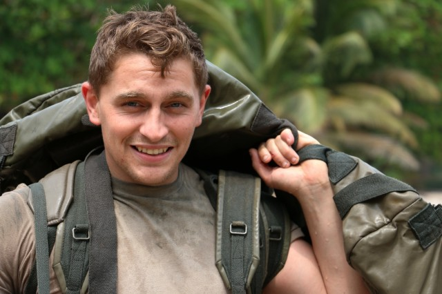 U.S. Army Spc. Alexander Neely, fire support specialist with Bravo Company, 3rd Battalion, 7th Infantry Regiment, 2nd Infantry Brigade Combat Team, 3rd Infantry Division smiles after completing a squad obstacle course during Jungle Warfare School in Gabon, June 10, 2016. Soldiers are attending the French Jungle Warfare School as part of U.S. Army Africa's exercise Central Accord 2016, an annual, combined, joint military exercise that brings together partner nations to practice and demonstrate proficiency in conducting peacekeeping operations.