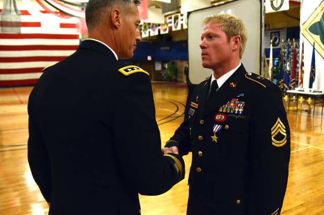 Sgt. 1st Class Richard Harris (right), a special forces soldier with 10th Special Forces Group (Airborne), shakes hands with Lt. Gen. Ken Tovo, commander of U.S. Army Special Operations Command after being awarded with the Silver Star medal June 3, 2016 at Fort Carson, Colo. Harris earned the Silver Star medal for heroic actions in Afghanistan on Sept. 13, 2011. (U.S. Army photo by Sgt. 1st Class Jeffrey Smith/Released)