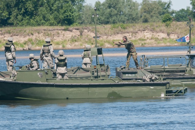 A Dutch soldier on a Bridge Erection Boat gives Soldiers from the 361st Engineer Company out of Warner Robins, Ga., some tips on how to maneuver the Improved Ribbon Bridge during bridge training on the Vistula River in Chelmno, Poland, as part of Exercise Anakonda 2016. Exercise Anakonda 2016 is a Polish-led, joint, multinational exercise taking place in Poland from June 7-17. This exercise involves more than 31,000 participants from more than 20 nations. Exercise Anakonda 2016 is a premier training event for U.S. Army Europe and participating nations and demonstrates that the U.S. and partner nations can effectively unite together under a unified command while training on a contemporary scenario.