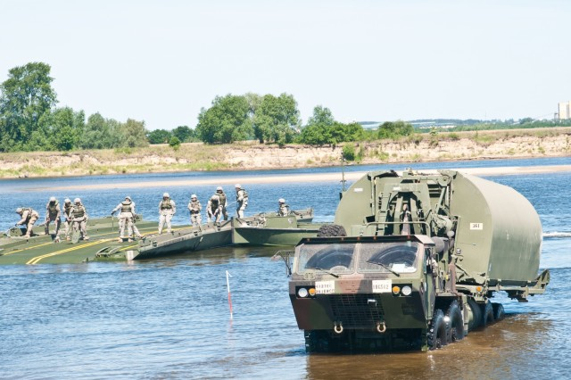Soldiers of the 361st Engineer Company from Warner Robins, Ga., sharpen their skills by constructing the Improved Ribbon Bridge on the Vistula River in Chelmno, Poland, as a part of Exercise Anakonda 2016. The IRB is a sectional floating bridge that can be used to create a full bridge or to ferry vehicles and equipment across a body of water. Exercise Anakonda 2016 is a Polish-led, joint, multinational exercise taking place in Poland from June 7-17. This exercise involves more than 31,000 participants from more than 20 nations. Exercise Anakonda 2016 is a premier training event for U.S. Army Europe and participating nations and demonstrates that the U.S. and partner nations can effectively unite together under a unified command while training on a contemporary scenario.
