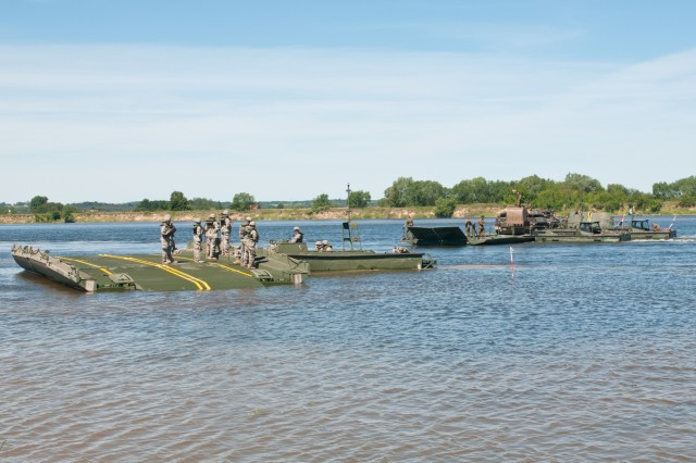 Soldiers of the 361st Engineer Company from Warner Robins, Ga., hone their skills on the Improved Ribbon Bridge on the Vistula River in Chelmno, Poland, alongside engineer elements from the German and Dutch armies as a part of Exercise Anakonda 2016. Exercise Anakonda 2016 is a Polish-led, joint, multinational exercise taking place in Poland from June 7-17. This exercise involves more than 31,000 participants from more than 20 nations. Exercise Anakonda 2016 is a premier training event for U.S. Army Europe and participating nations and demonstrates that the U.S. and partner nations can effectively unite together under a unified command while training on a contemporary scenario.