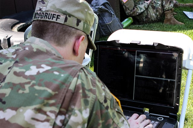 2nd Lt. Ed Woodruff, adjusts the autonomous robot vehicle for competition mode for the Intelligent Ground Vehicle Competition, hosted by Oakland University in Rochester, Michigan. The project is sponsored by Tank Automotive Research, Development and Engineering Center or TARDEC (U.S. Army photo by Kathy Eastwood, USMA West Point Public Affairs/released.)