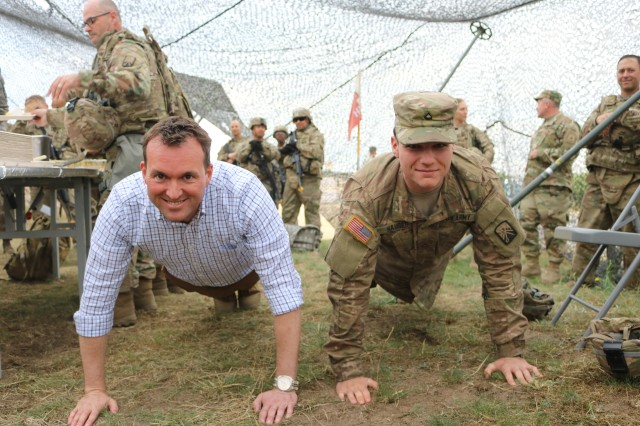 Secretary of the Army Eric Fanning and Pvt. 1st Class Jacob Hauser earned their cake doing push-ups. Hauser starred in two of the #EarnYourCake clips that sparked Fannings impromptu visit to LSA Warhammer, June 14.