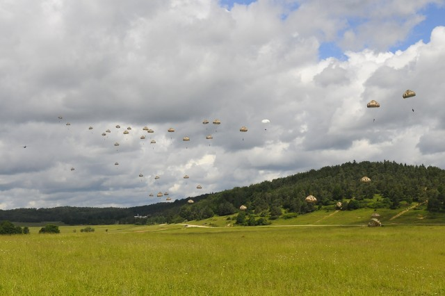 Soldiers of the 11e Brigade Paracutiste descend onto Hohenfels Drop Zone in Germany during Exercise Swift Response, June 15, 2016. Exercise Swift Response is one of the premier military crisis response training events for multi-national airborne forces in the world. The exercise is designed to enhance the readiness of the combat core of the U.S. Global Response Force -- currently the 82nd Airborne Division's 1st Brigade Combat Team -- to conduct rapid-response, joint-forcible entry and follow-on operations alongside Allied high-readiness forces in Europe. Swift Response 16 includes more than 5,000 Soldiers and Airmen from Belgium, France, Germany, Great Britain, Italy, the Netherlands, Poland, Portugal, Spain and the United States and takes place in Poland and Germany, May 27-June 26, 2016