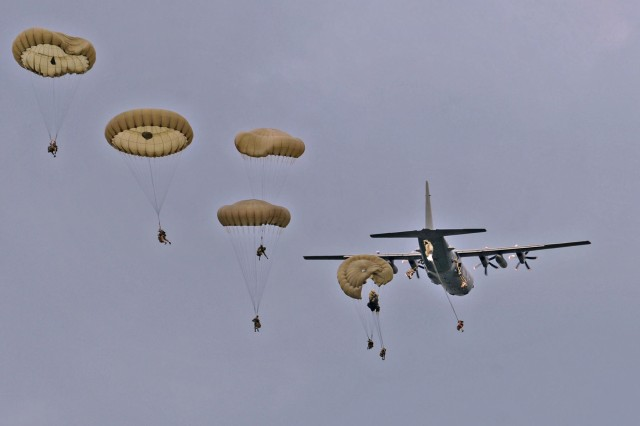 British soldiers from the 16 Air Assault Brigade  exit a C-130 above Hohenfels Drop Zone in Germany during Exercise Swift Response, June 15, 2016. Exercise Swift Response is one of the premier military crisis response training events for multi-national airborne forces in the world. The exercise is designed to enhance the readiness of the combat core of the U.S. Global Response Force -- currently the 82nd Airborne Division's 1st Brigade Combat Team -- to conduct rapid-response, joint-forcible entry and follow-on operations alongside Allied high-readiness forces in Europe. Swift Response 16 includes more than 5,000 Soldiers and Airmen from Belgium, France, Germany, Great Britain, Italy, the Netherlands, Poland, Portugal, Spain and the United States and takes place in Poland and Germany, May 27-June 26, 2016