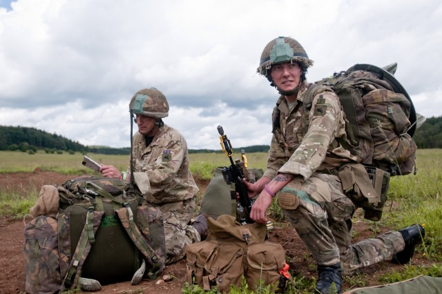 British soldiers from the 16 Air Assault Brigade recover their parachutes and prepare to march to their unit's assembly area. Exercise Swift Response is one of the premier military crisis response training events for multi-national airborne forces in the world. The exercise is designed to enhance the readiness of the combat core of the U.S. Global Response Force -- currently the 82nd Airborne Division's 1st Brigade Combat Team -- to conduct rapid-response, joint-forcible entry and follow-on operations alongside Allied high-readiness forces in Europe. Swift Response 16 includes more than 5,000 Soldiers and Airmen from Belgium, France, Germany, Great Britain, Italy, the Netherlands, Poland, Portugal, Spain and the United States and takes place in Poland and Germany, May 27-June 26, 2016