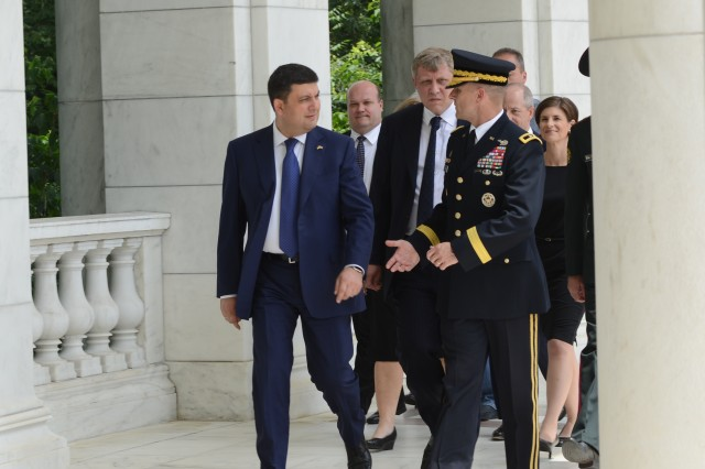 His Excellency Volodymyr Groysman, Prime Minister of Ukraine, listens to Maj. Gen. Bradley A. Becker, commanding general, Joint Force Headquarters-National Capital Region and the U.S. Army Military District of Washington, after an Armed Forces Full Honor Wreath-Laying Ceremony with at the Tomb of the Unknown Soldier, June 15, 2016.
