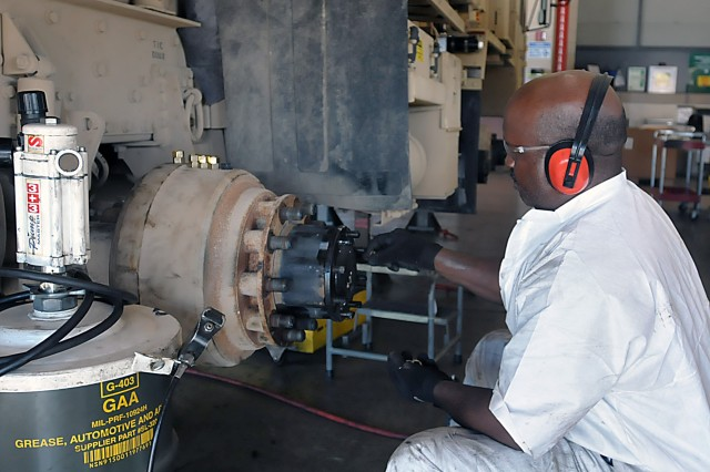 This LRC-Hood maintenance employee tightens a wheel hub on a vehicle at Fort Hood, Texas. (Photo by Jon Micheal Connor, ASC Public Affairs)