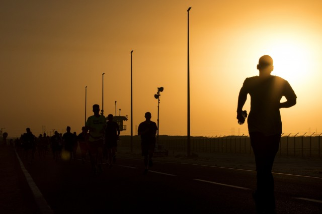 The sun rises over troops in the early morning hours during the U.S. Army's 241st Birthday 10k run June 14, hosted by the MWR at Camp Arifjan, Kuwait. Servicemembers from all branches of our Armed Forces showcased their physical readiness by running, rucking and walking in honor of the U.S. Army's Birthday. (Photo by Spc. Angela Lorden/Released)