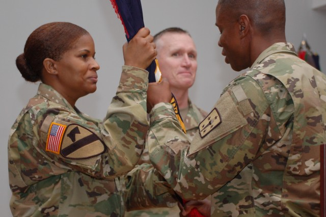 Adjutant General School Command Sgt. Major Nyeedra Edwards, left, receives the colors from Col. Neal McIntyre, during a change of commandant ceremony last Friday at the Soldier Support Institute. McIntyre became the 19th chief of the Adjutant General Corps, the 32nd commandant of the Adjutant General School and the 18th chief of Army music, taking over from Col. Jack Usrey, center.
