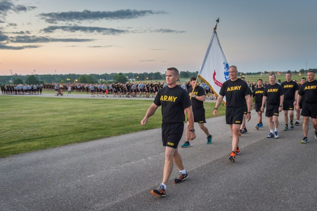 Maj. Gen. Kent Savre, MSCoE and Fort Leonard Wood commanding general, leads runners to begin the division-style run.