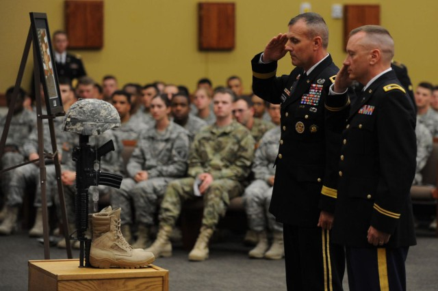 Maj. Gen. J.T. Thompson, commanding general of 1st Cavalry Division and Chaplain (Lt. Col.) Dennis Hyson, who delivered the rulogu, present their final salutes during Cadet Mitchell Winey's memorial ceremony, June 9.