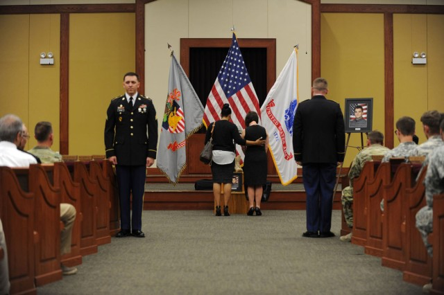 Mourners pay respect for Cadet Mitchell Winey during his memorial, Jun 9, at Fort Hood.